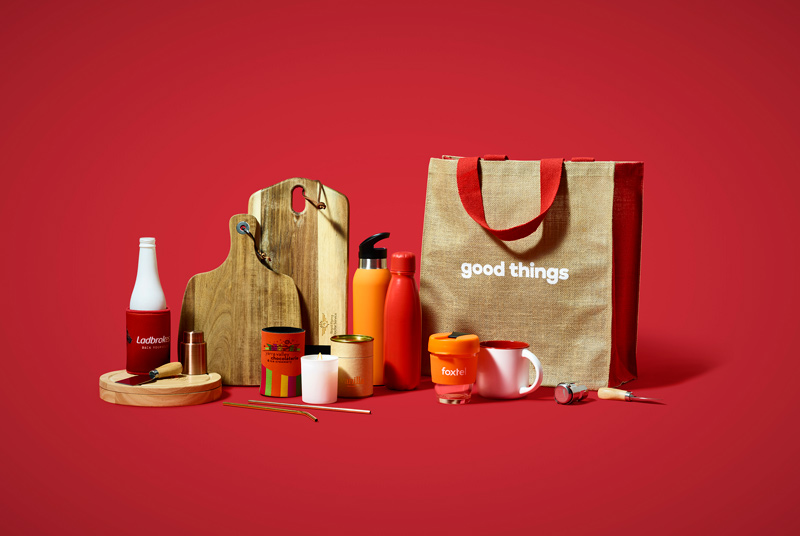 Promotional products including branded tote bag, cheese board, stubby holder, coffee cups and drink bottles made by Good Things